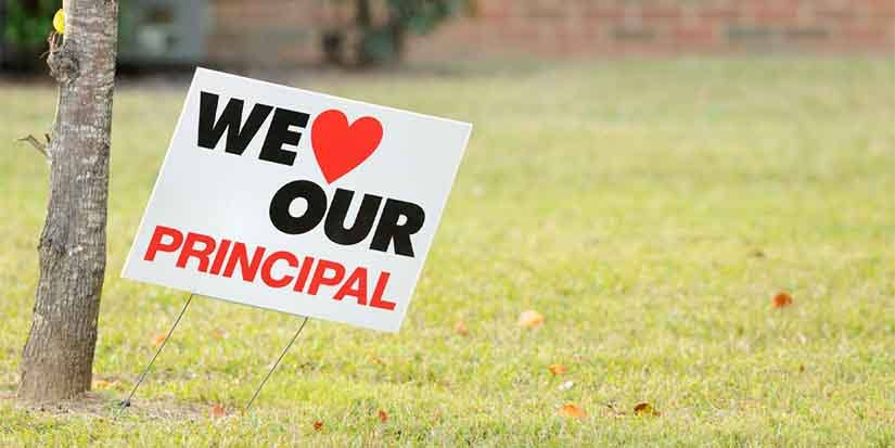"Lawn sign displaying, ""We Love Our Principal."""