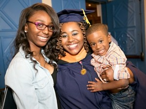 female graduate with her sister and baby