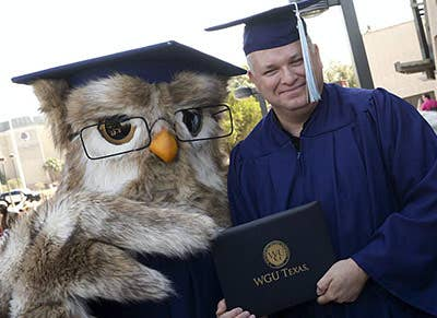 At commencement with a proud new WGU Grad