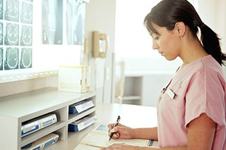 Nurse working on paperwork