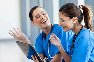 Nursing professionals having a good laugh