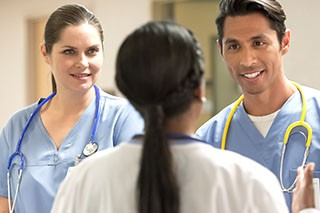 Nurses discussing patient care and protocol with doctor