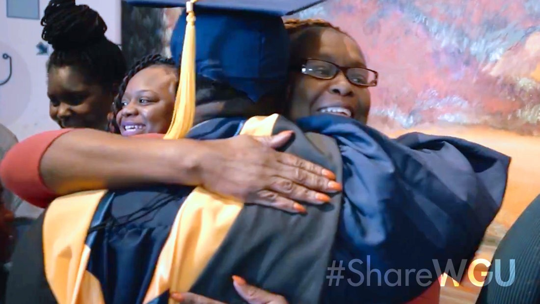 Rashaan Green hugs his mom after graduating with his Master's degree in IT, his second degree from WGU